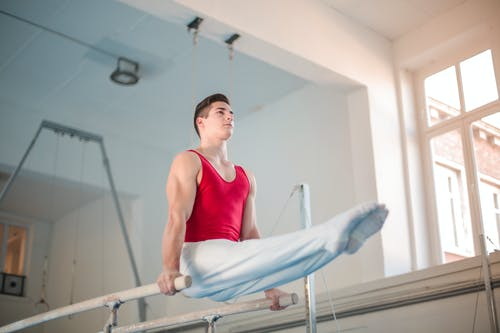 Photo of Male Gymnast Practicing in Gym