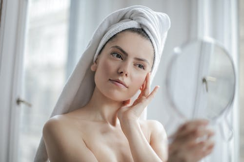 Topless Woman With Towel on Head