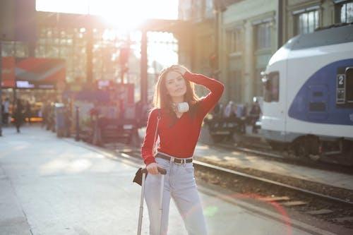 Serious woman posing at railroad station