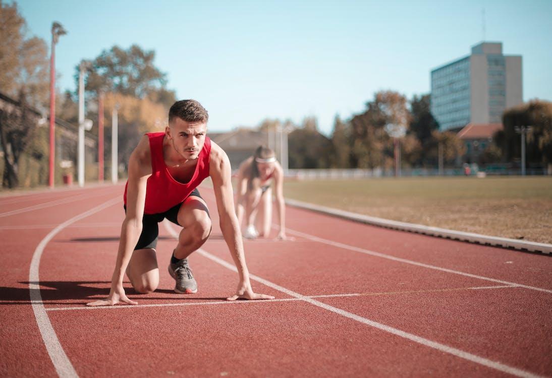 Strong sportsmen ready for running on stadium