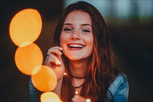 Woman in Blue Denim Jacket Smiling