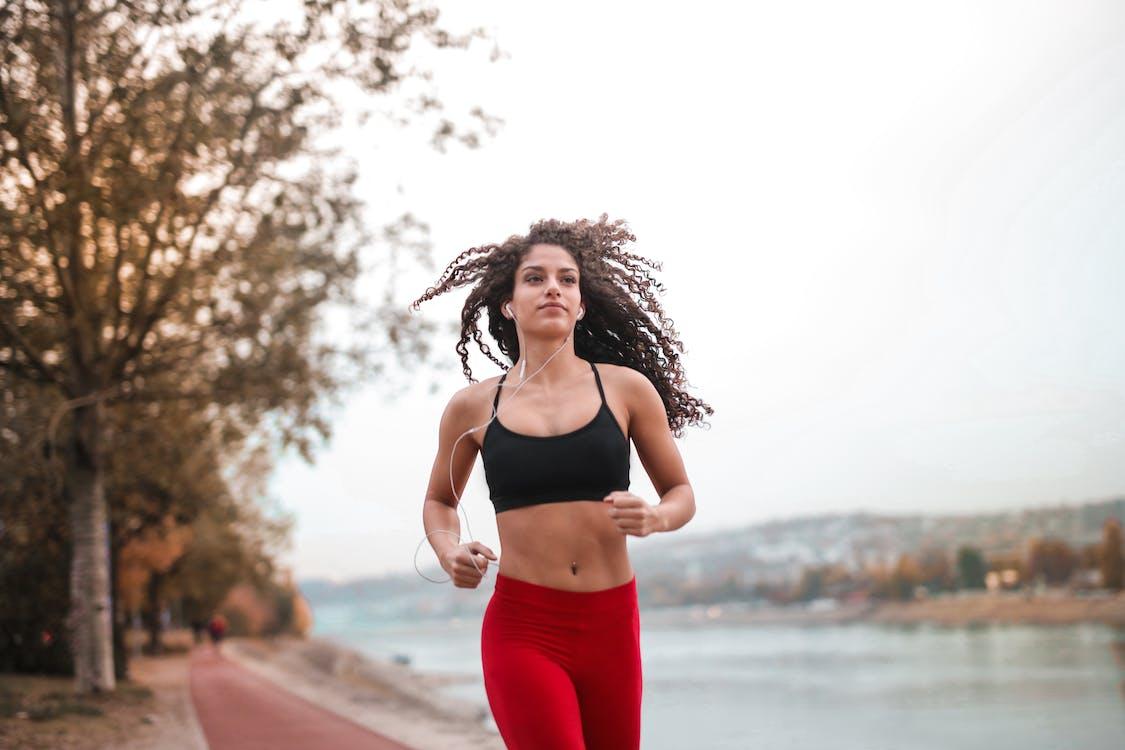 Woman in Black Sports Bra Running