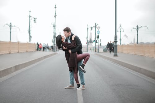 Couple is About to Kiss in the Middle of the Roadway