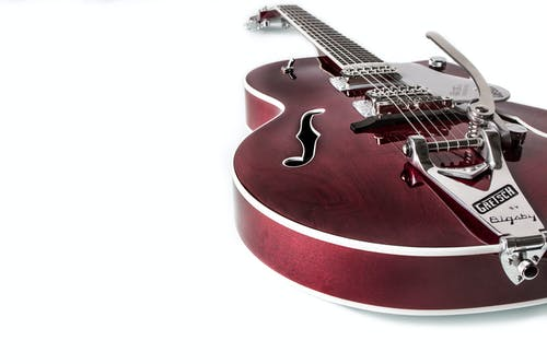 Red Jazz Guitar on White Surface