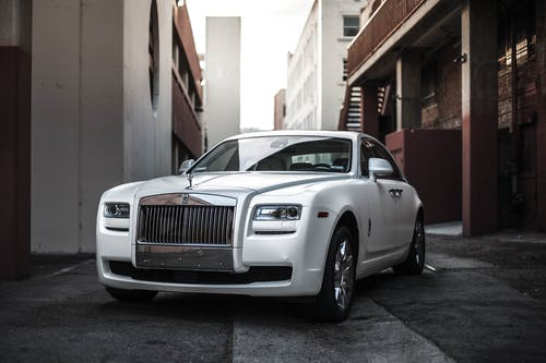 Photo of White Rolls Royce Ghost Parked in an Alley