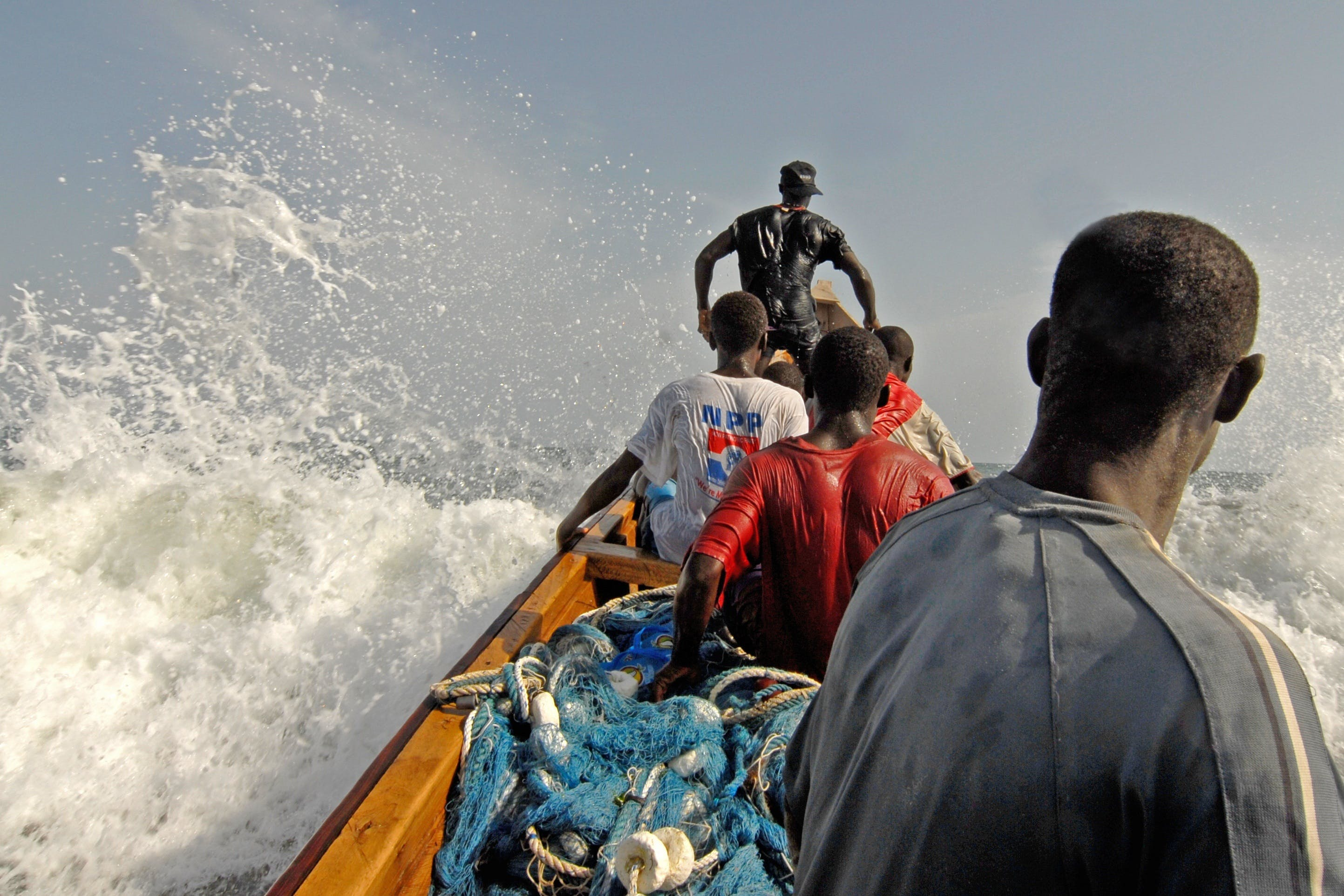 Five Men Riding on Boat