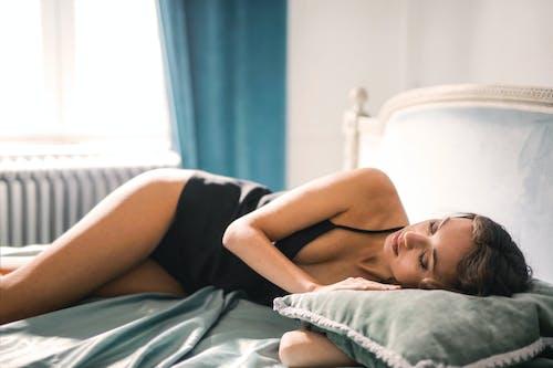 Selective Focus Photo of Woman in Black Sleepwear Sleeping on Bed