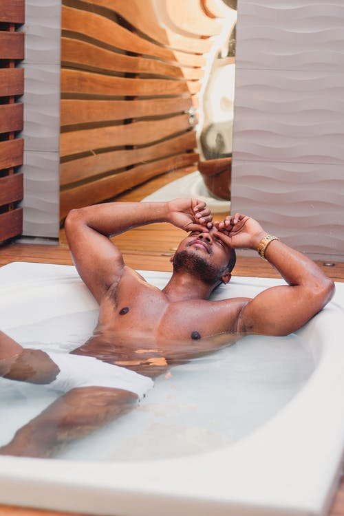 Man Unwinding in a Large Tub