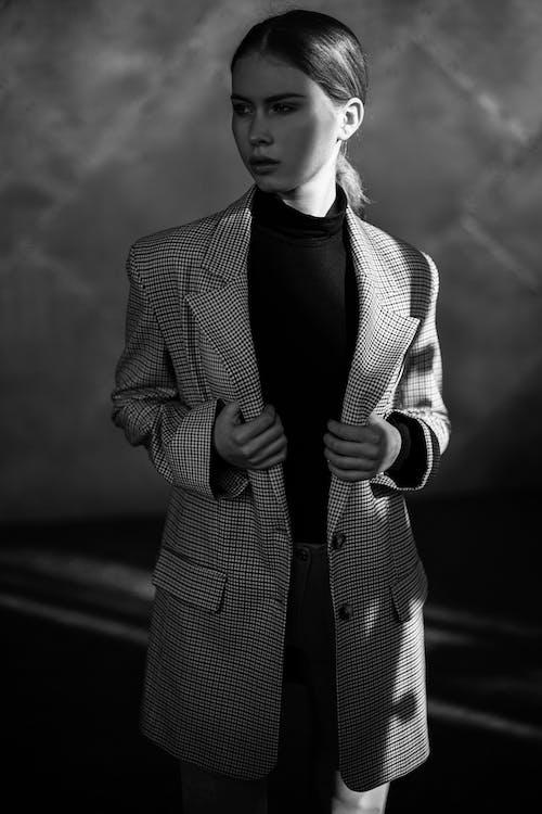 Woman in Black and White Striped Blazer