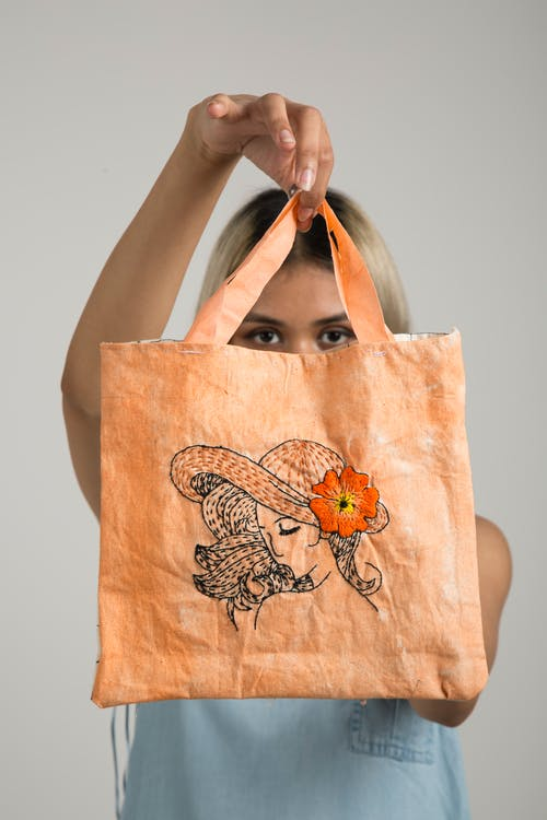 Woman Holding Orange Bag