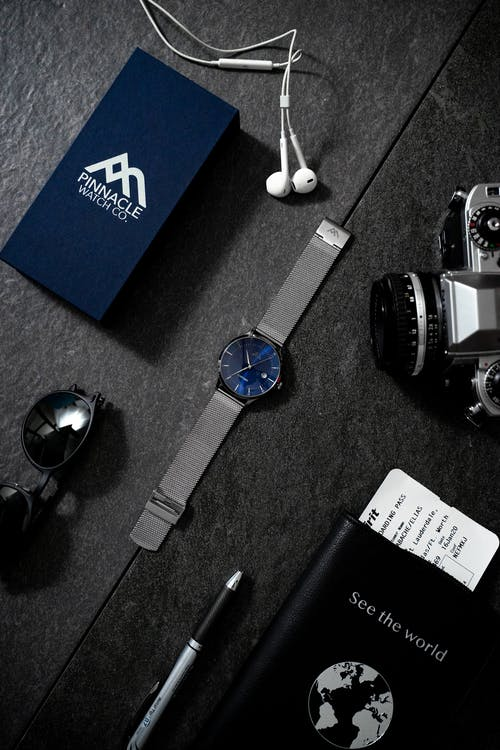 Sapphire Analog Watch Beside Analog Camera