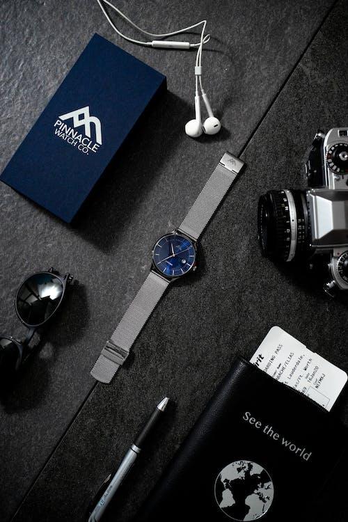 Sapphire Analog Watch Beside Analog Camera