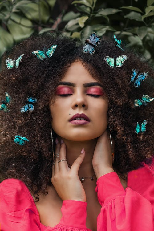 Woman With Butterfly Accessories On Hair