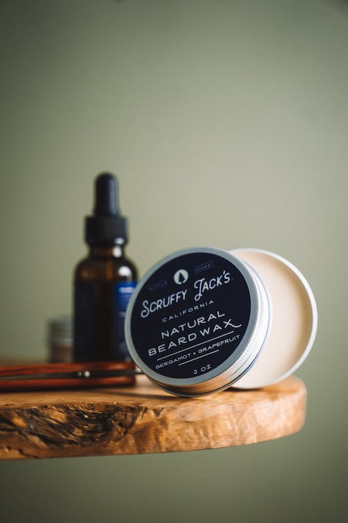 Beard Wax On A Round Wooden Table