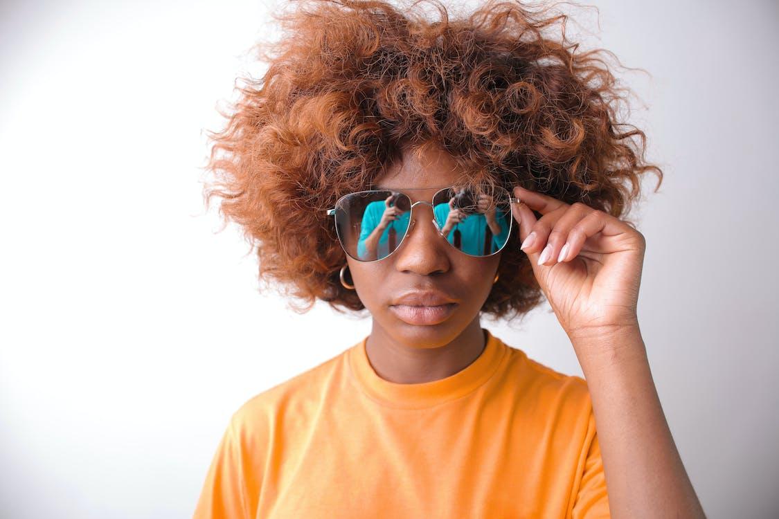 Woman in Orange Crew Neck Shirt Wearing Blue Sunglasses