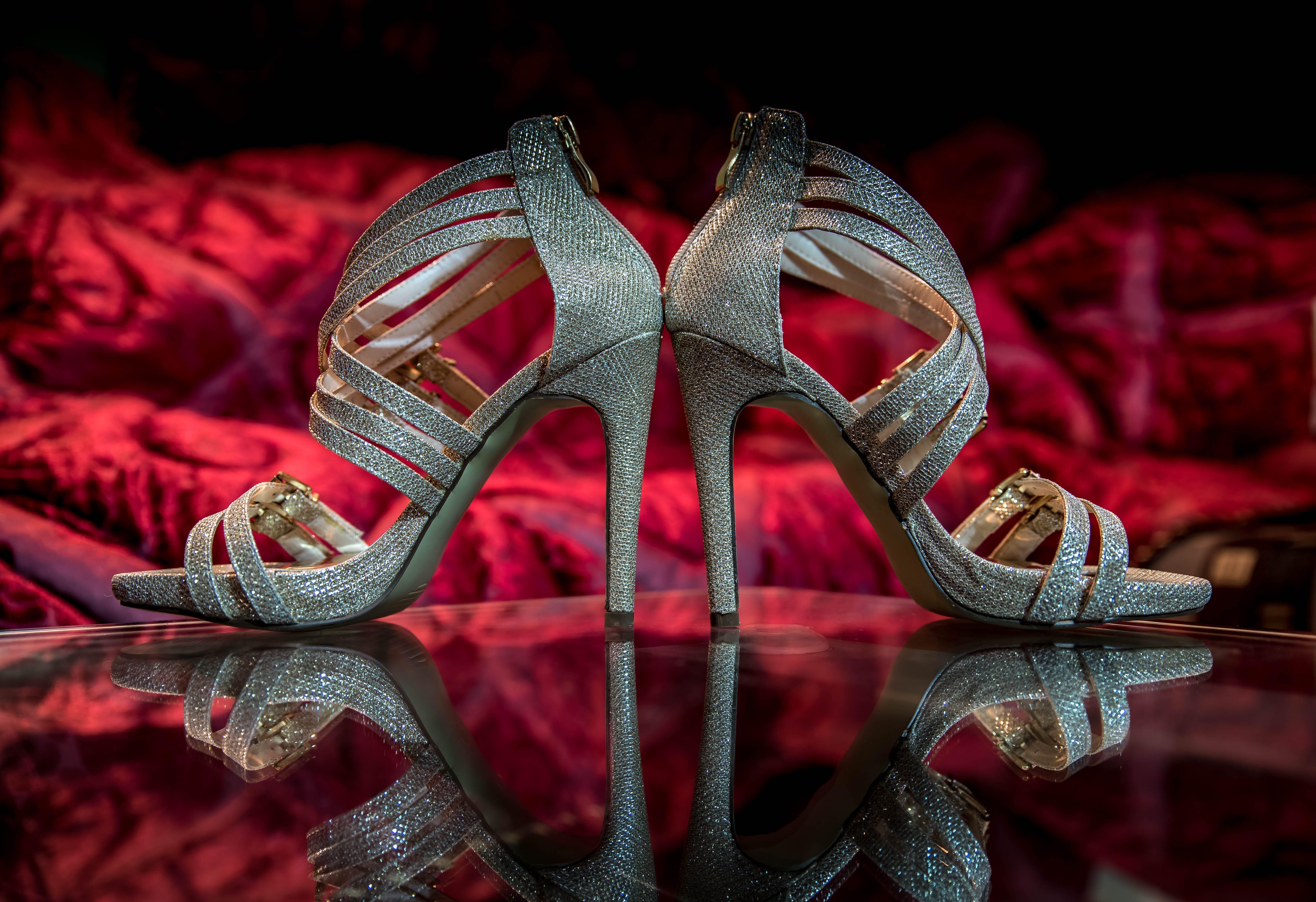 Pair of Silver Open-toe Heeled Sandals on Floor