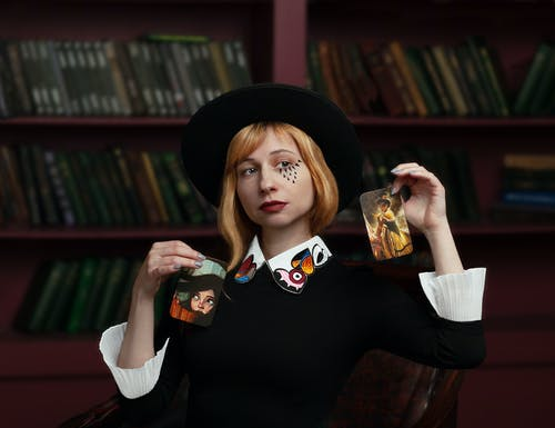 Stylish young woman showing focus with cards
