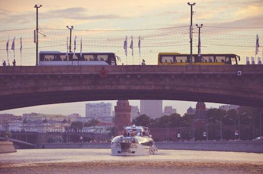 Free stock photo of bridge, boat, bus, river