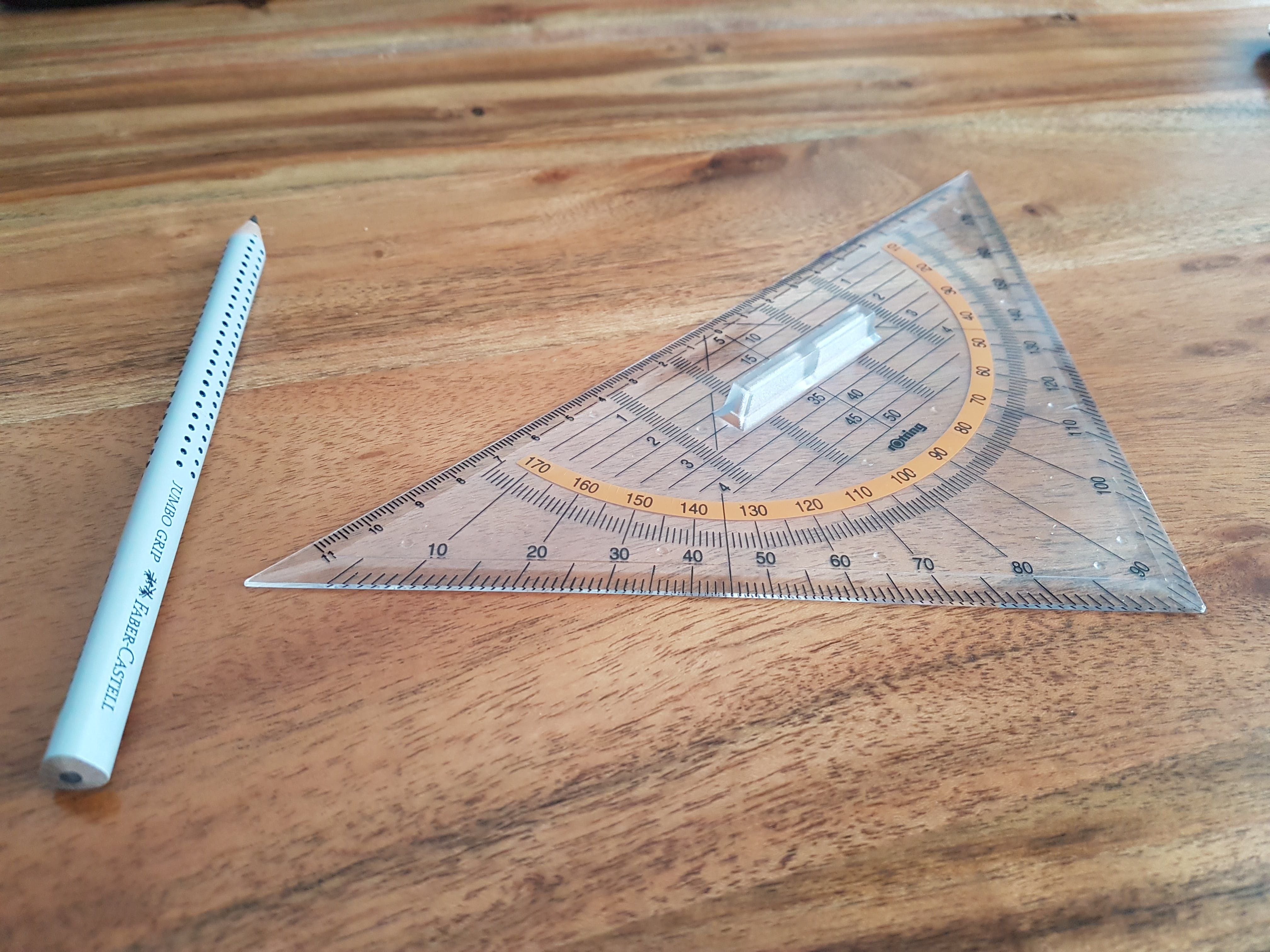 Gray Pencil and Triangular Ruler on Brown Wooden Surface