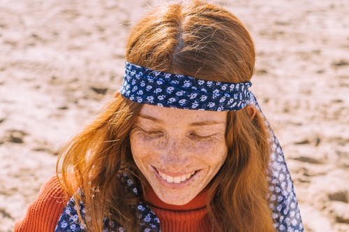Portrait Photo of Smiling Woman with Freckles in Orange Turtleneck Sweater and Floral Headscarf