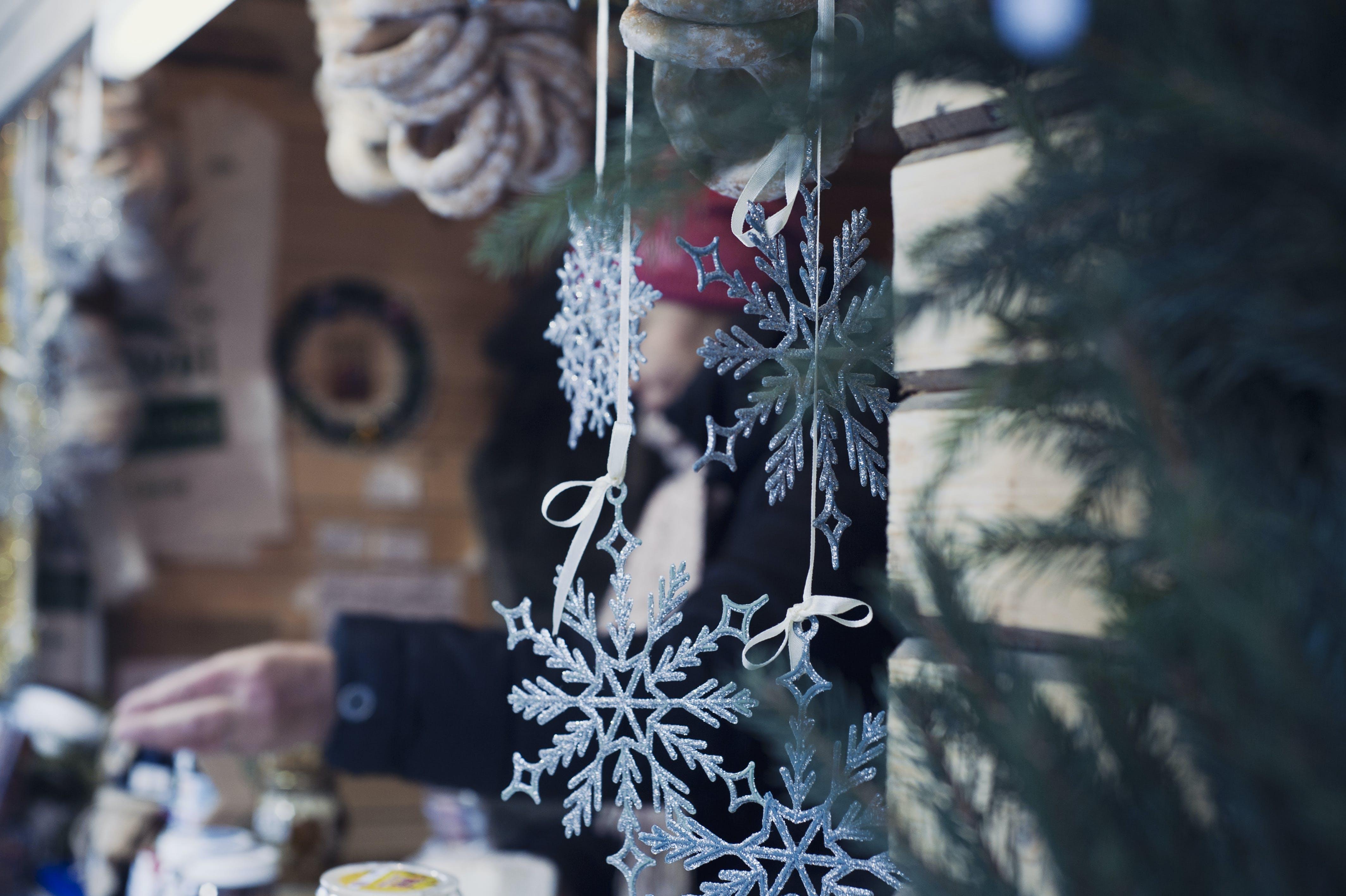 Shallow Focus Photography of Snowflakes Christmas Tree Decor