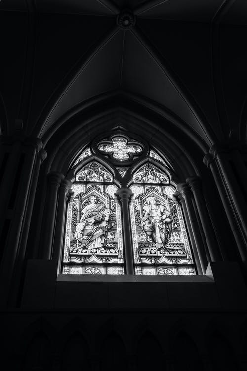 Arched stained glass window inside church