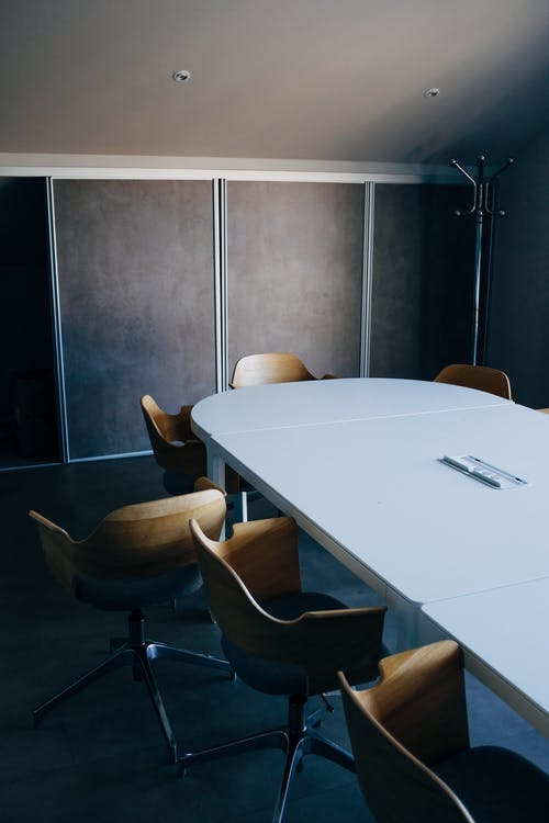 Oval table and chairs in modern meeting room