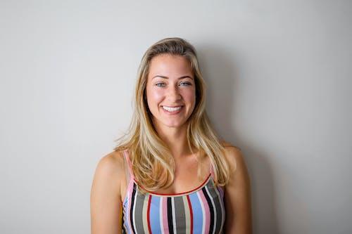 Woman Smiling While Wearing Stripe Tank Top