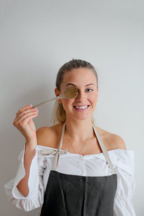 Woman in White Spaghetti Strap Top While Smiling