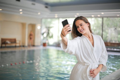 Woman Taking Selfie Using Her Smartphone