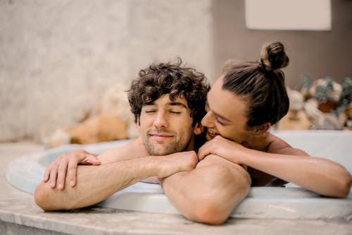 Man and Woman on Bathtub