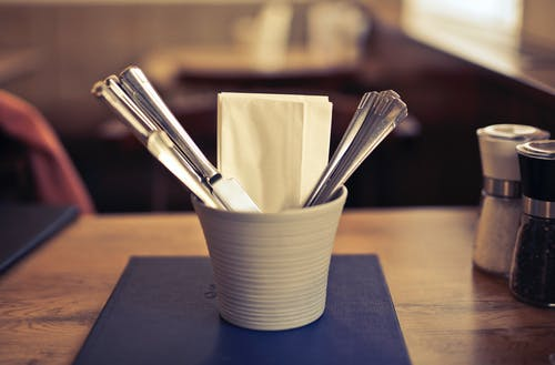 Stainless Steel Fork on White Ceramic Cup