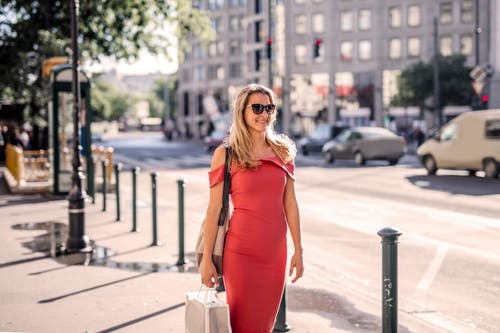 Woman Wearing Red Dress and Sunglasses