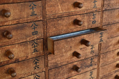 Brown Wooden Cabinets With Japanese Letters