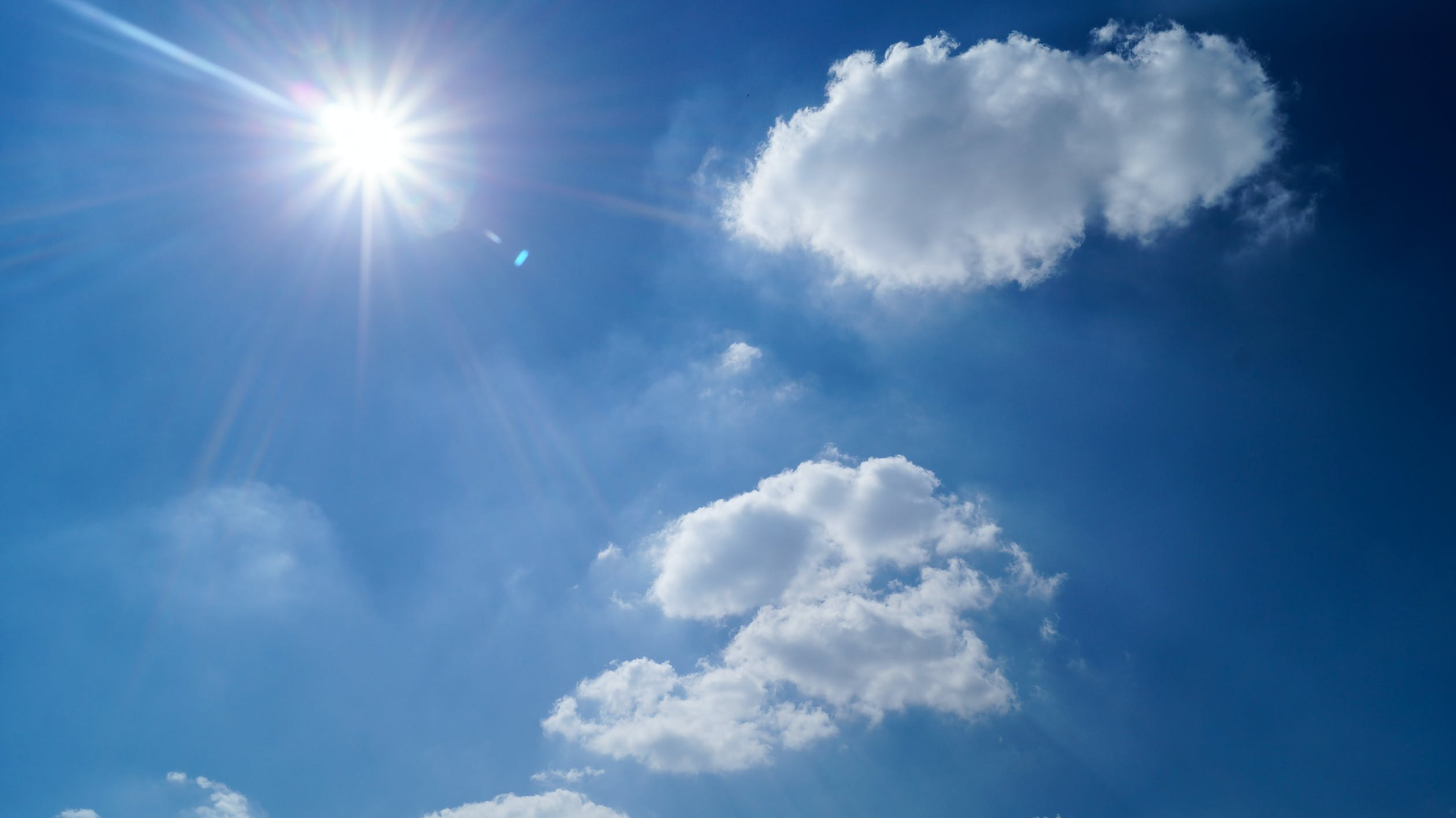 sunshine with some clouds and blue sky