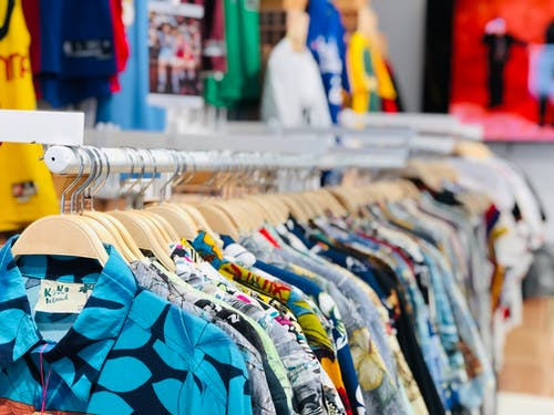 Shallow Focus Photo of Clothing Rack