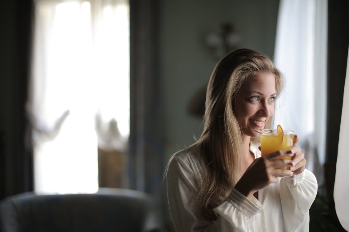 Woman Holding Drinking Glass With Juice