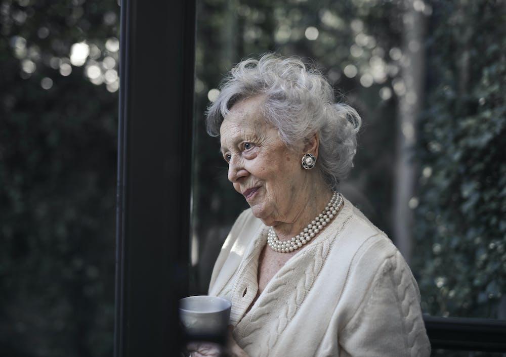 Woman holding a ceramic mug.   Photo: Pexels