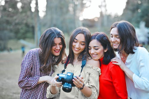 Photo of Women Smiling While Looking at the Camera
