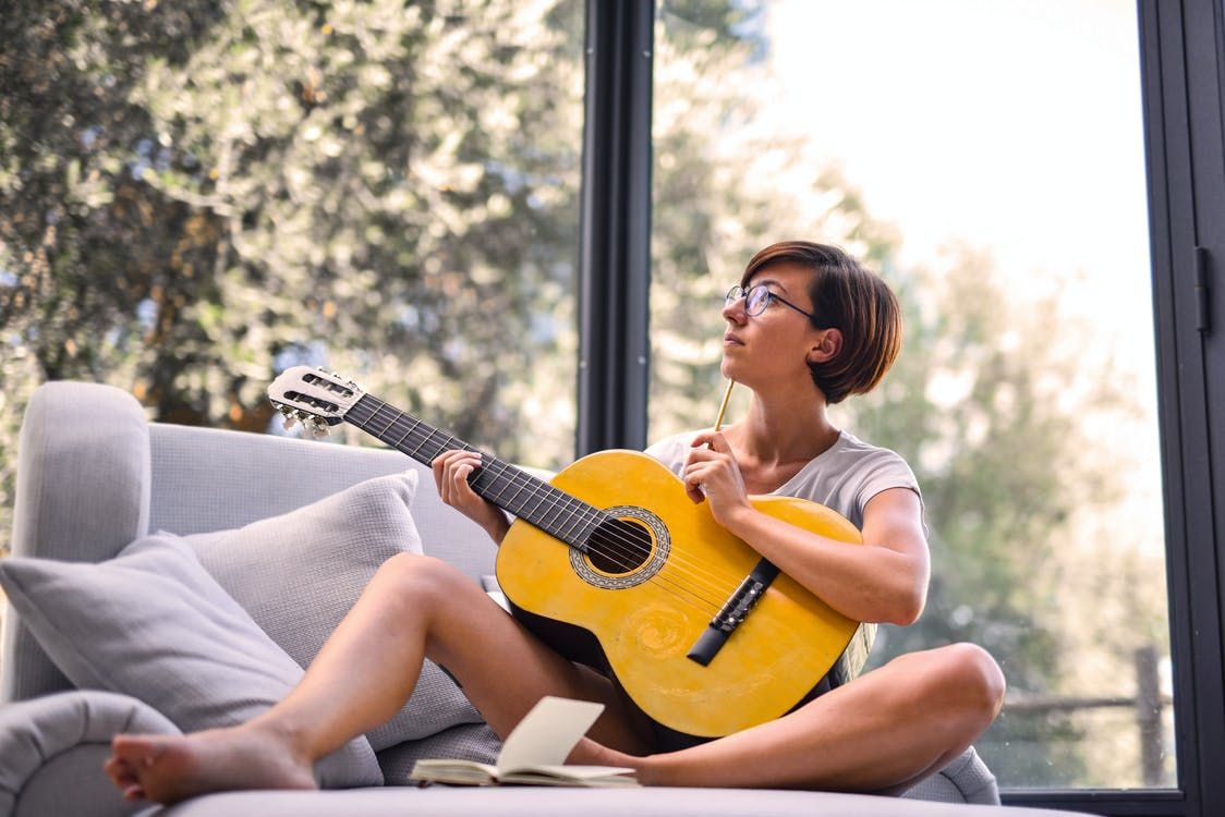 Woman Holding Acoustic Guitar