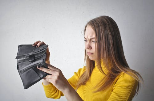 Woman Holding Black Wallet