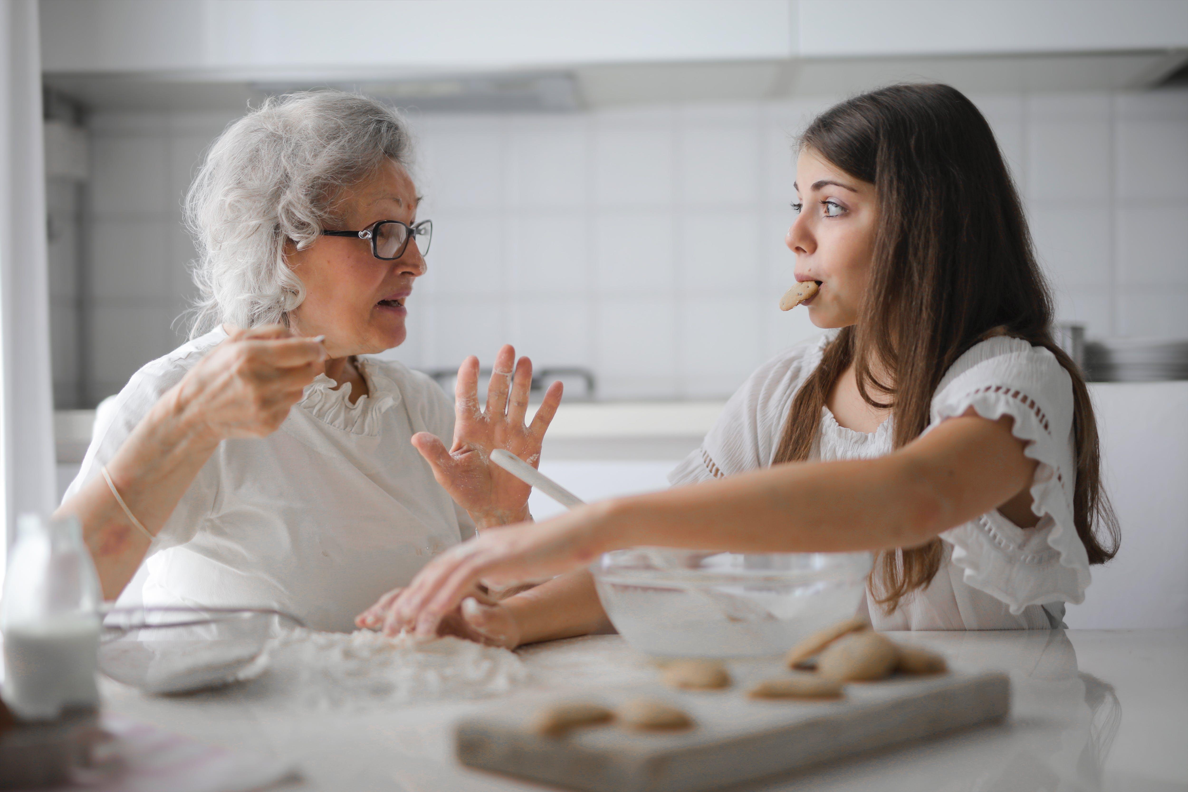Grandmother and her granddaughter having interesting conversation. | Photo: Pexels