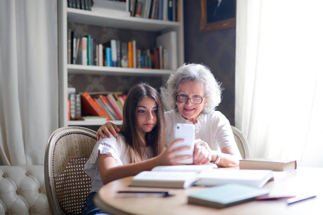 Woman Showing Her Cellphone to Her Grandmother