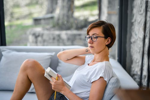 Photo of Woman Sitting on Sofa