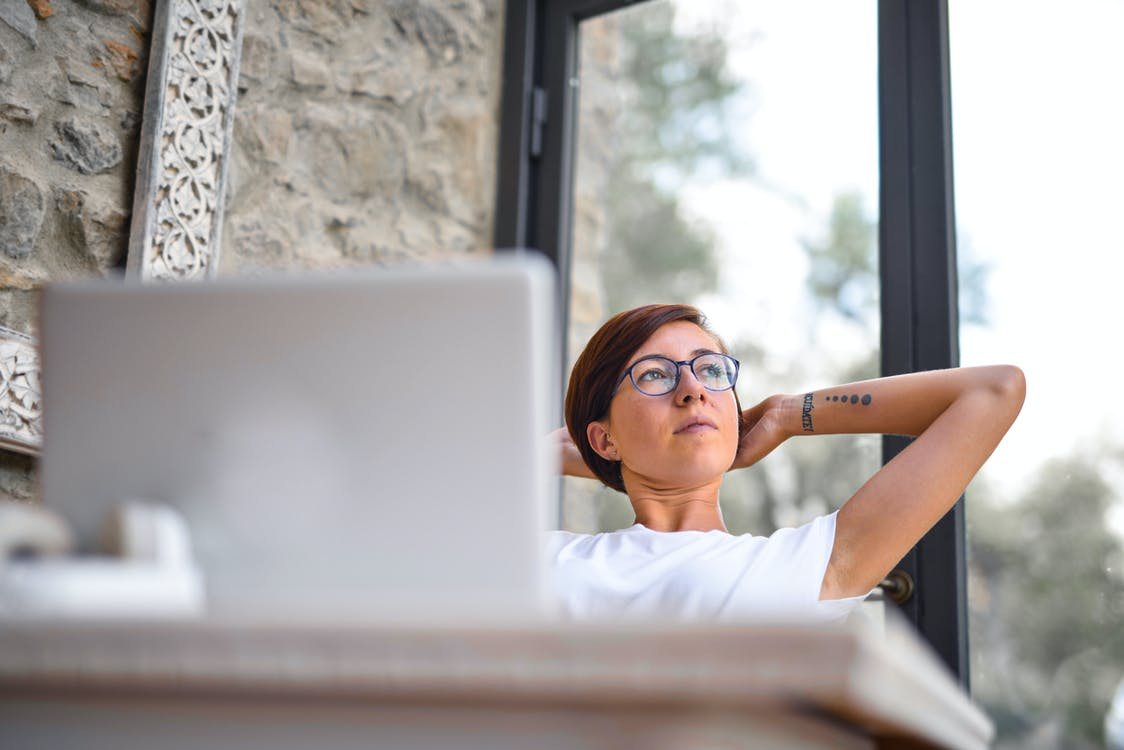 Woman in White Crew Neck T-shirt Wearing Black Framed Eyeglasses