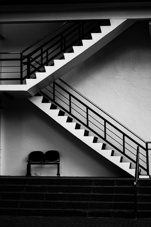 Black and White Staircase With Black Metal Railings