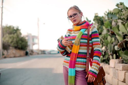 Woman in Multi Colored Scarf and Sweater