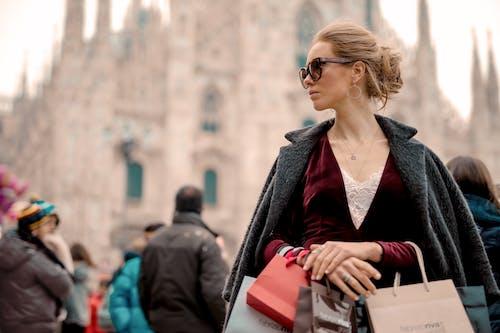 Woman in Black Coat Wearing Black Framed Sunglasses