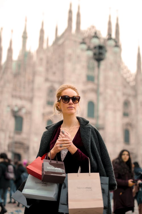 Woman in Black Coat Wearing Sunglasses