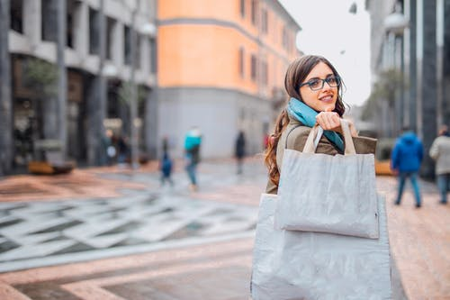 Woman Carrying Tote Bags